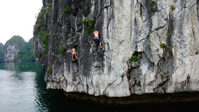 Climb rocks in Halong bay